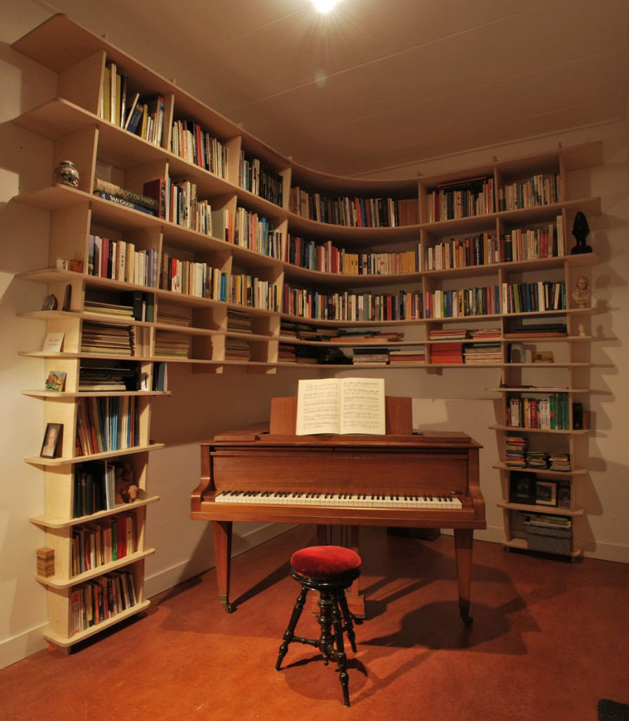 bookcase around piano forte